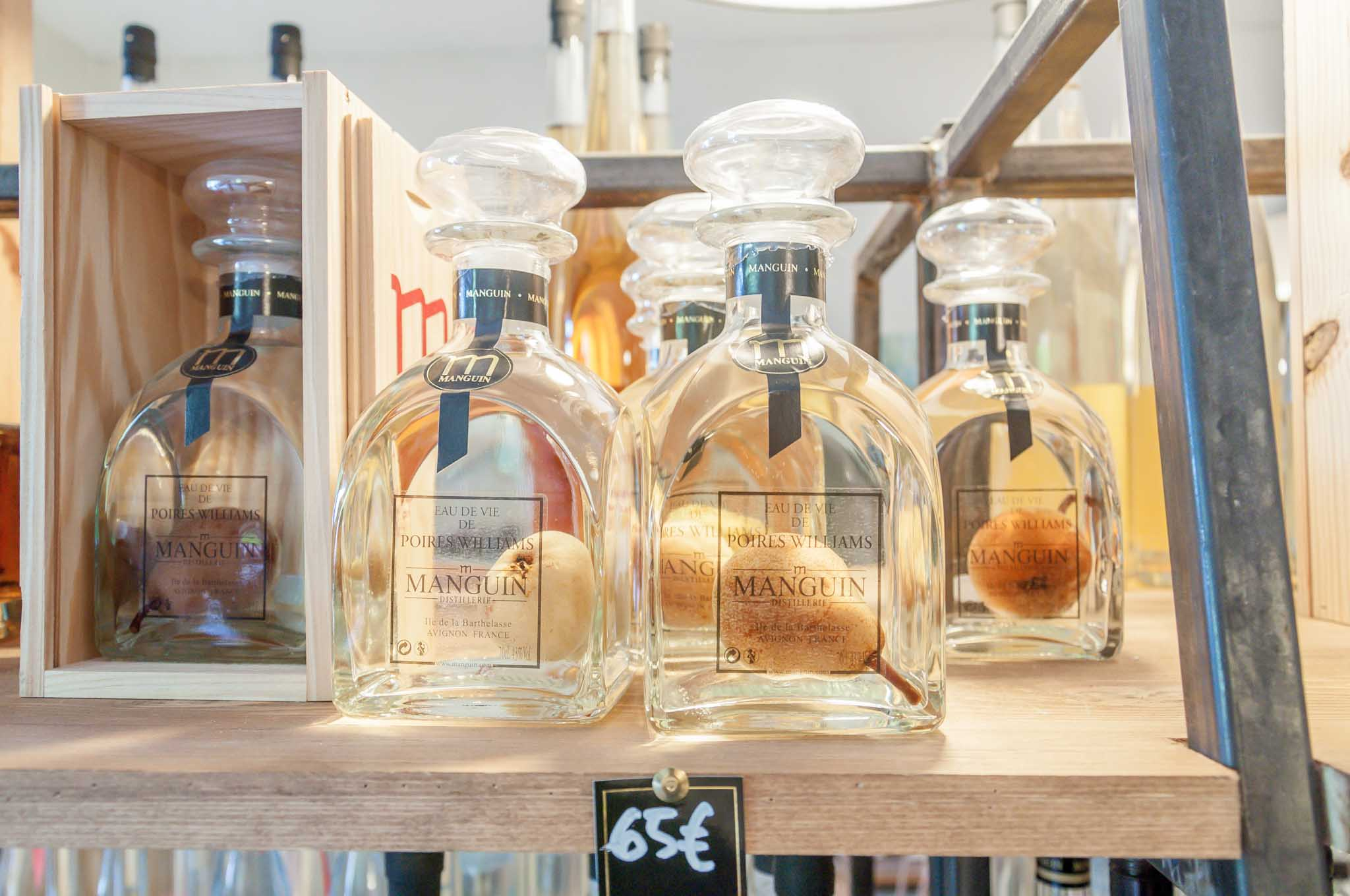 Bottles of pear brandy with a pear inside them
