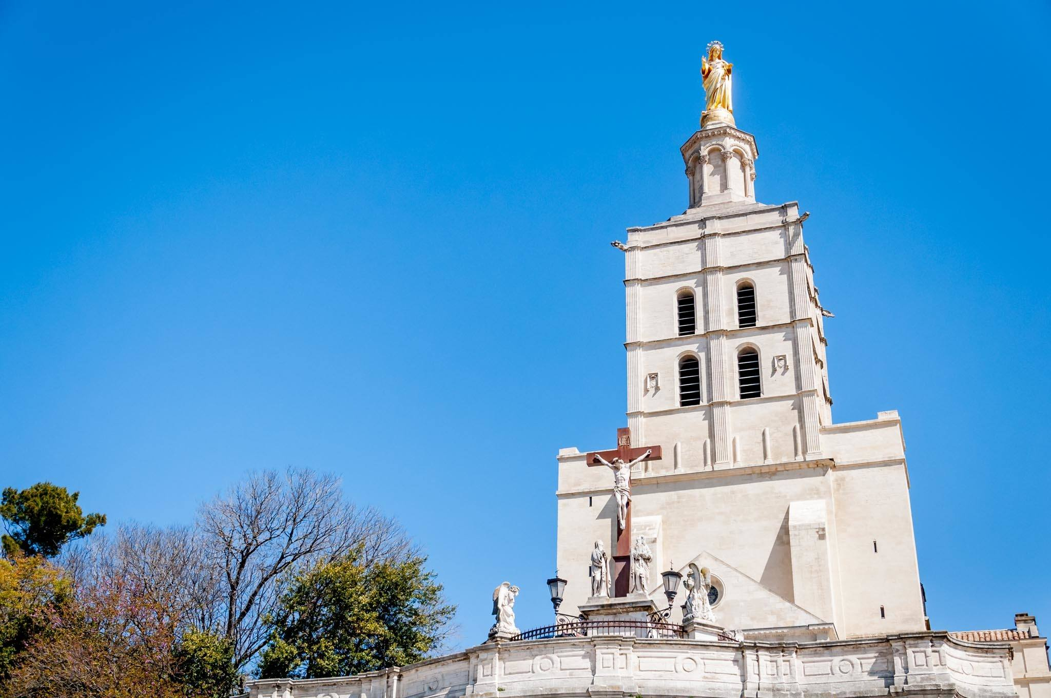 Avignon Cathedral bell tower topped with gold statue of Virgin Mary