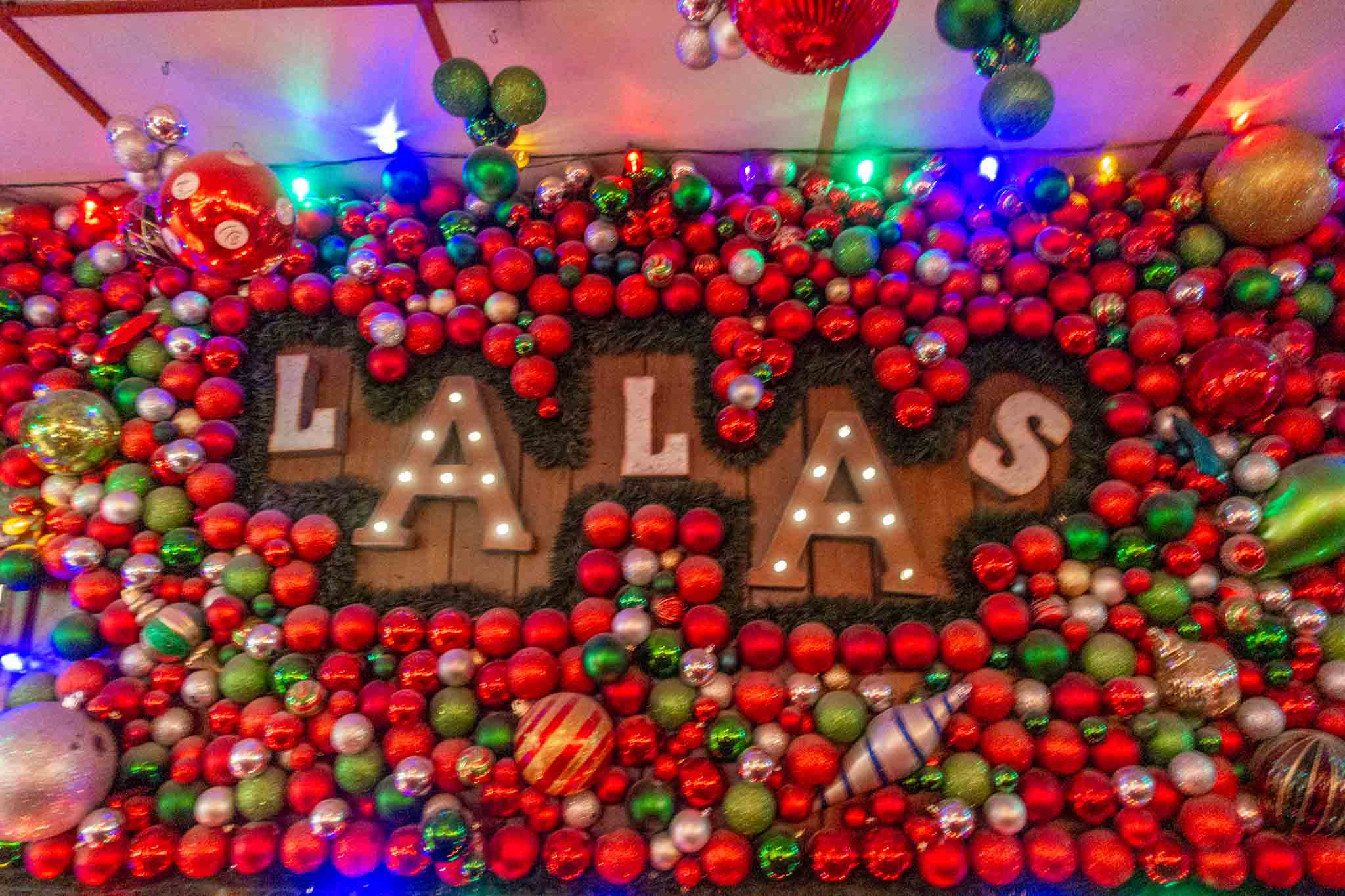 Lala's sign surrounded by Christmas ornaments