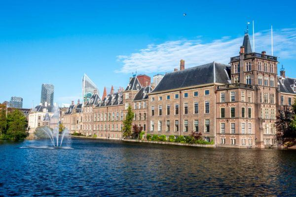 Large brick building beside a pond, the Binnenhof
