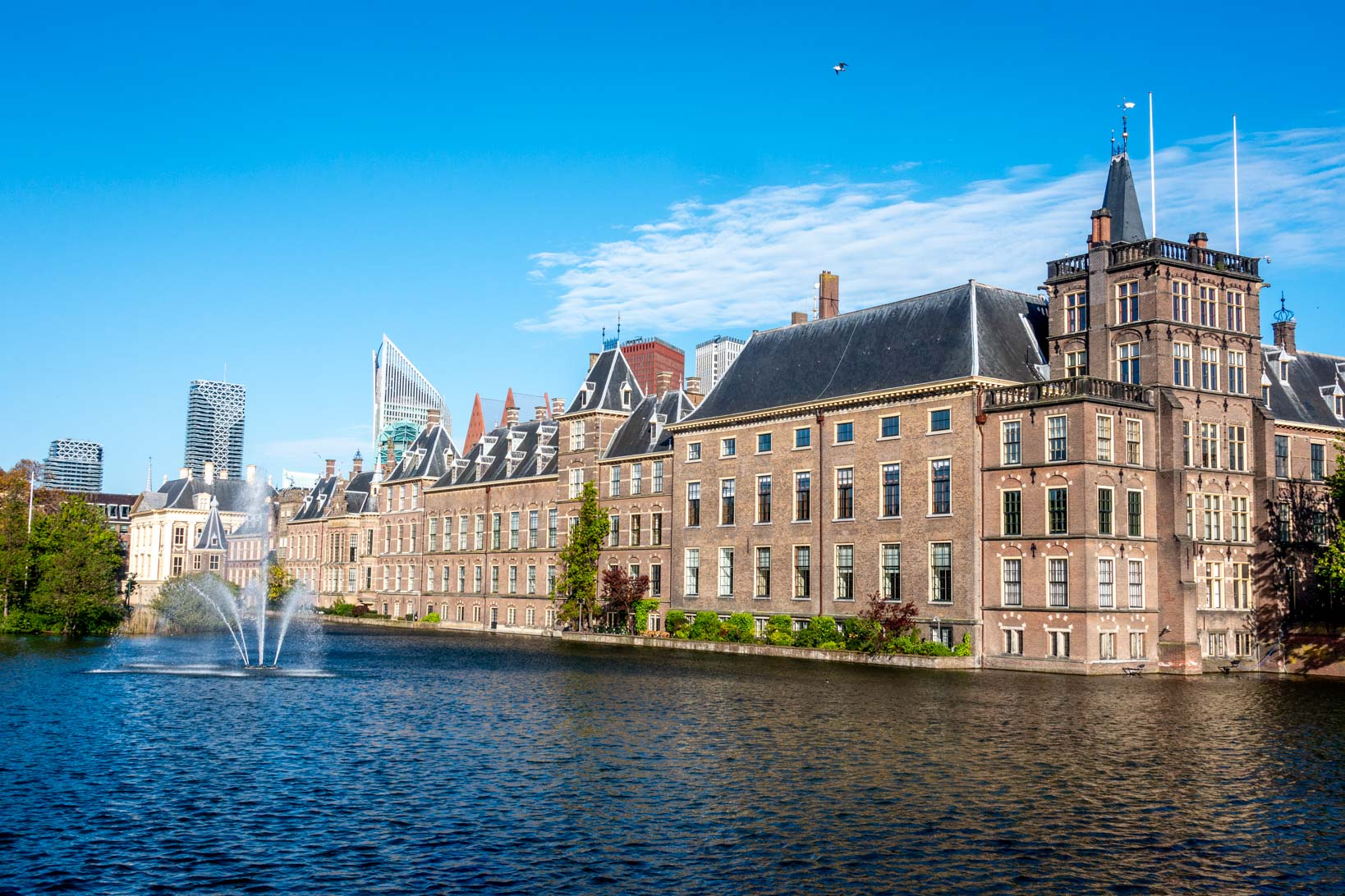 Large brick building beside a pond, the Binnenhof