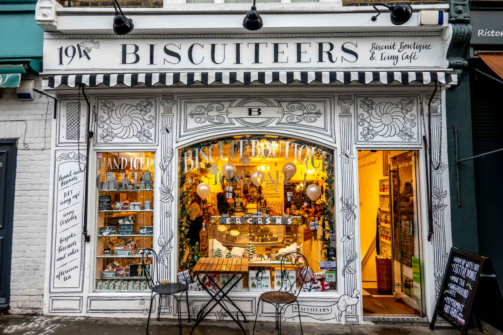Black and white exterior of Biscuiteers cafe