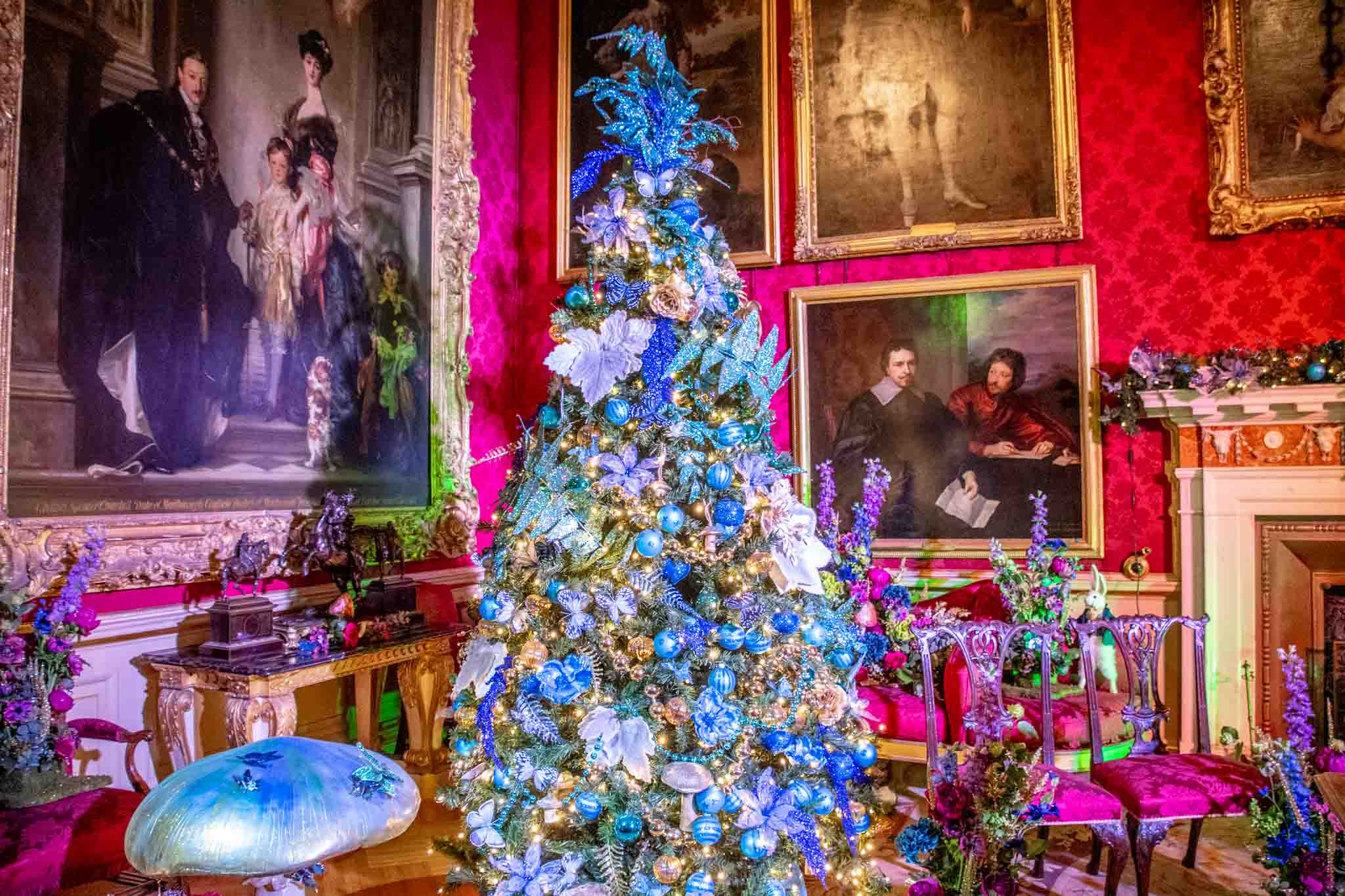 Decorated Christmas tree in a room filled with portraits