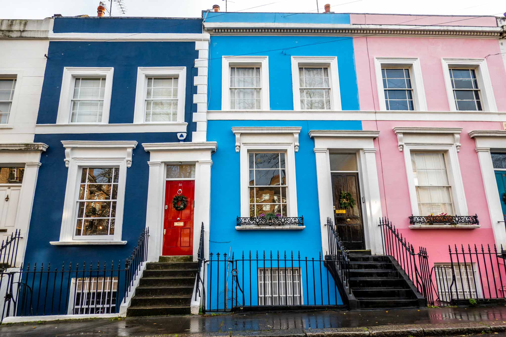 Blue and pink terrace homes in Notting Hill, London