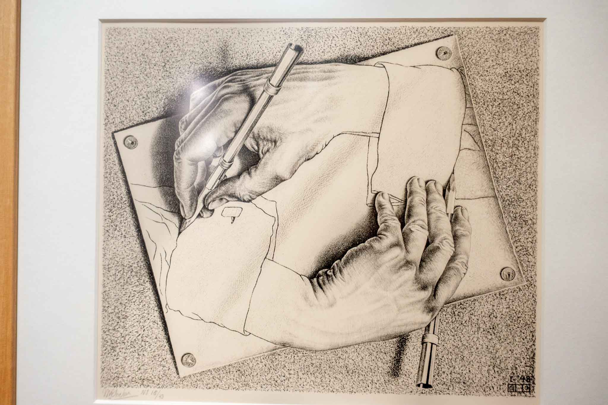 Artwork of two hands drawing each other