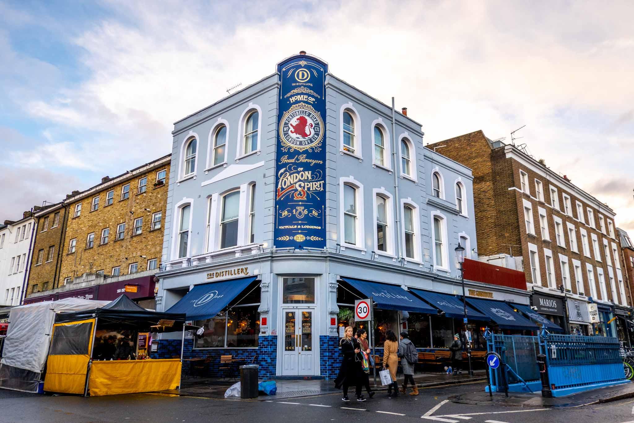Corner building painted blue, The Distillery on Portobello Road