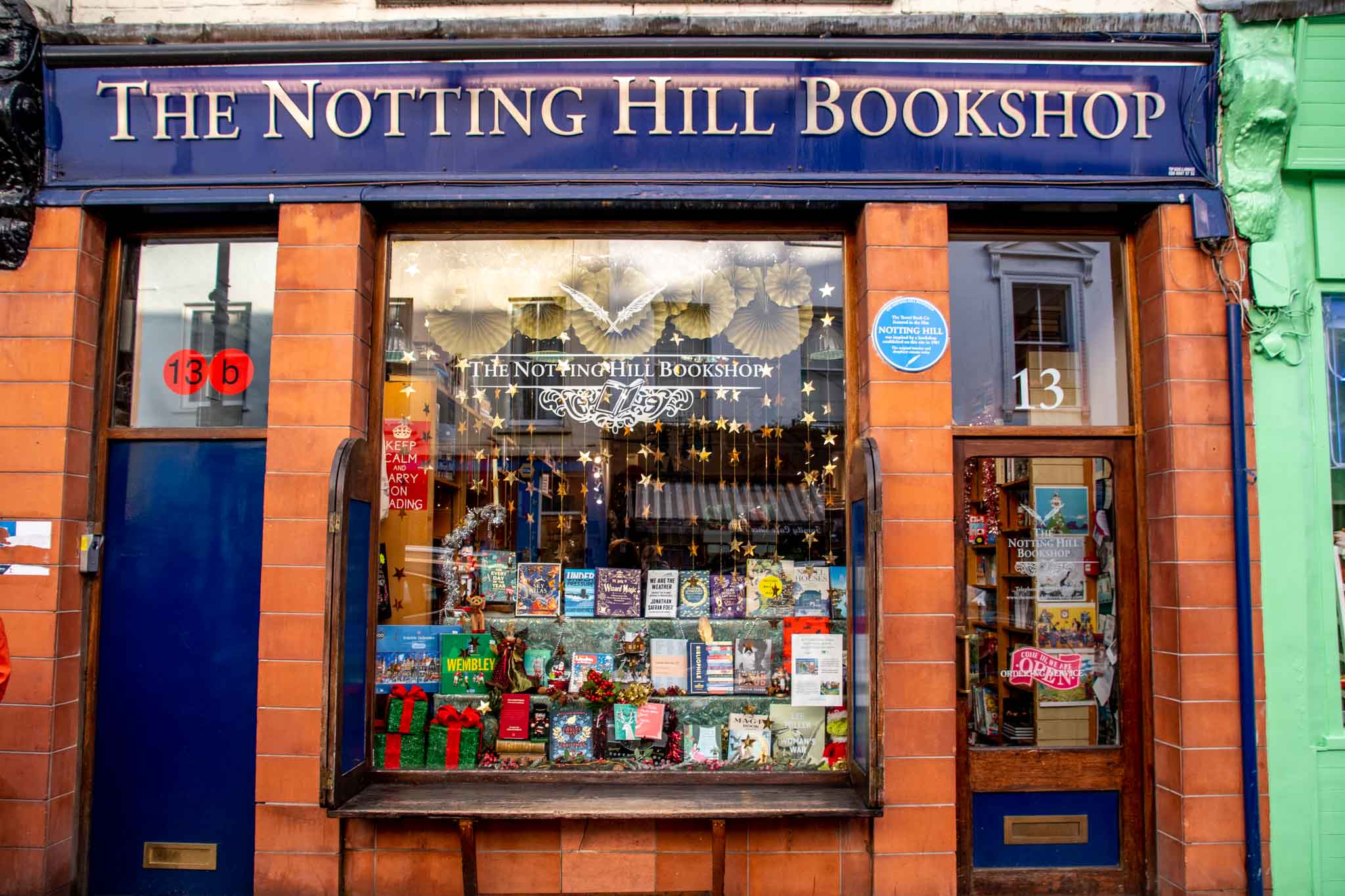Brick exterior of Notting Hill Bookshop with a blue sign
