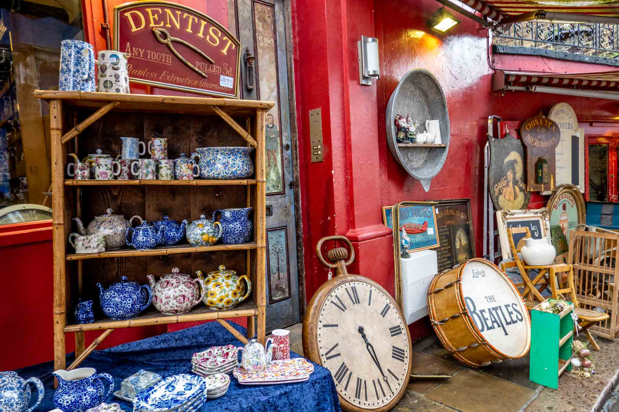 Teapots, ceramics, and other items displayed outside antique shop