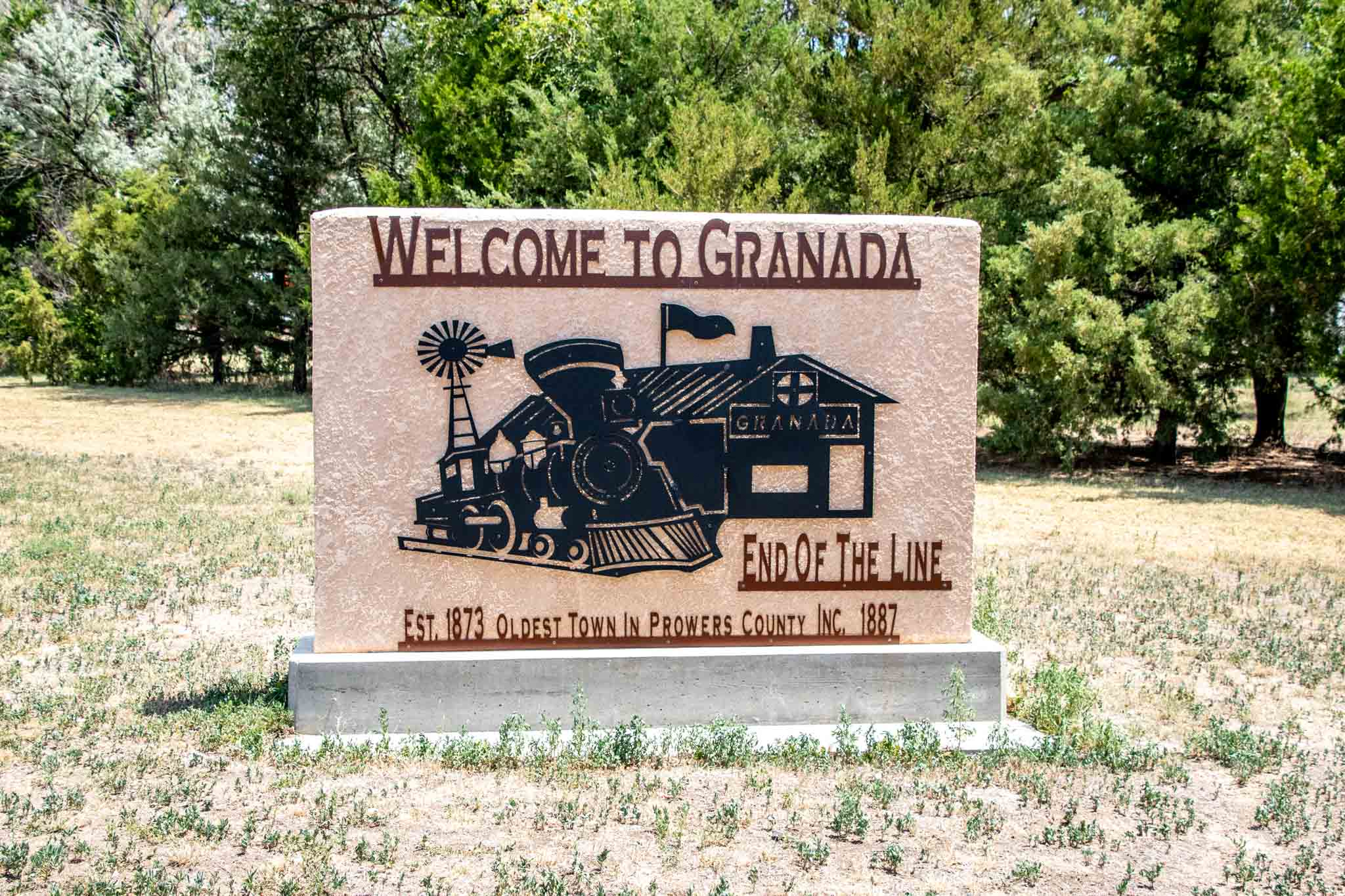 Sign saying Welcome to Granada, End of the Line, Established 1873, oldest town in Prowers County