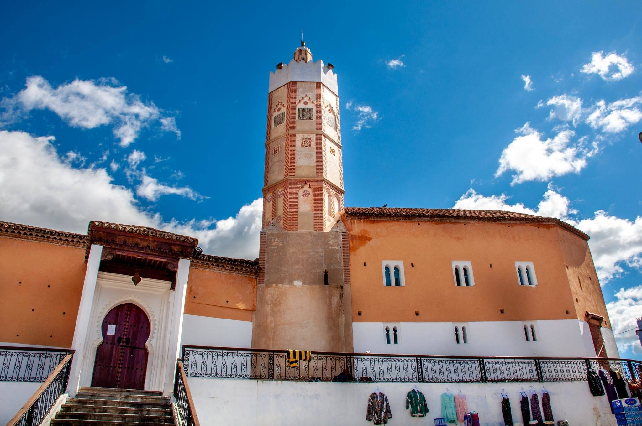 Orange building with a minaret, the Grand Mosque in Chefchaouen