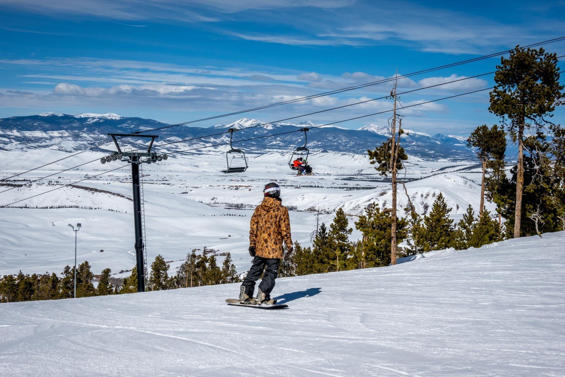 Snowboarder at Granby Mountain Ranch near ski lift