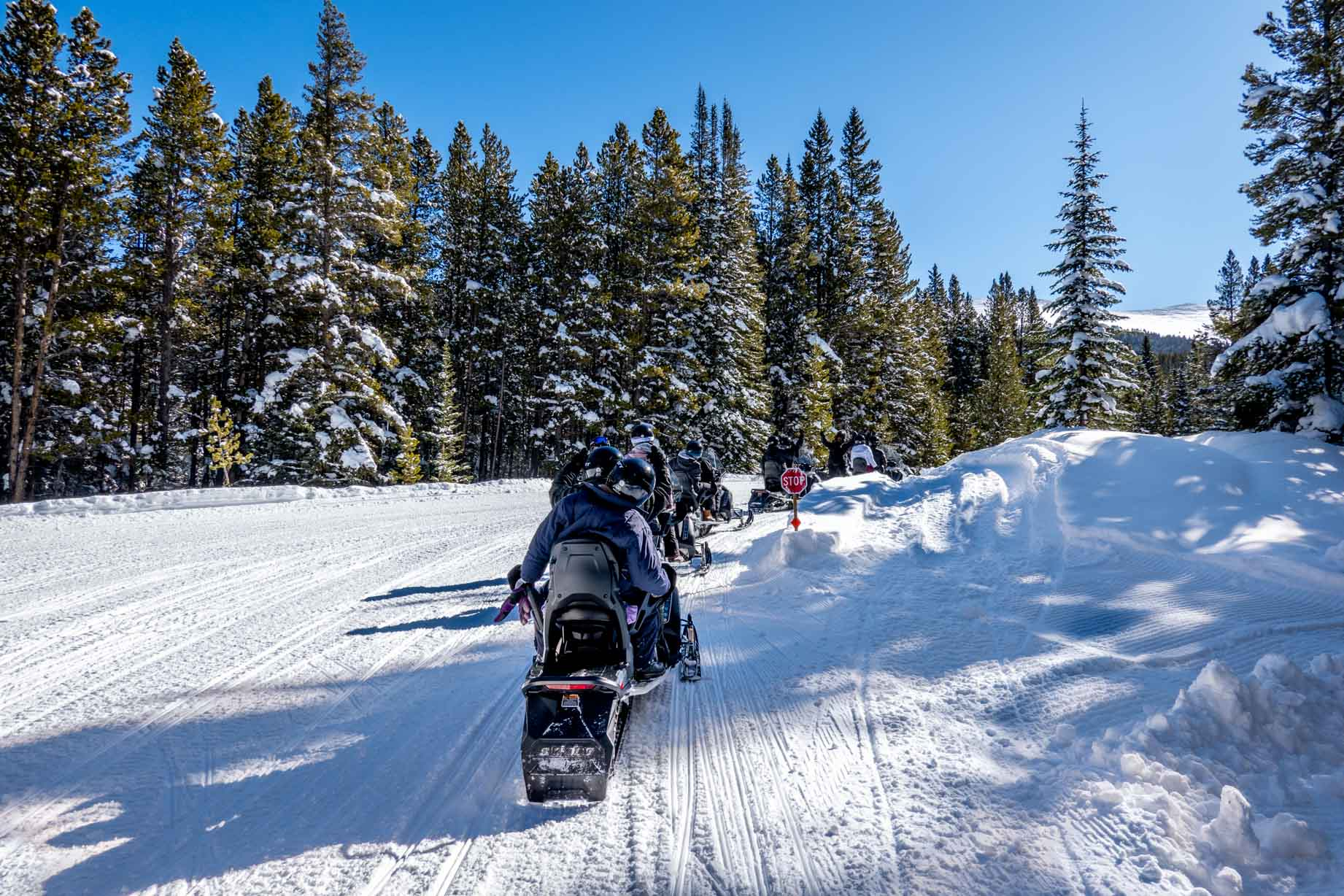 Group going snowmobiling in Winter Park up to the Corona Bowl