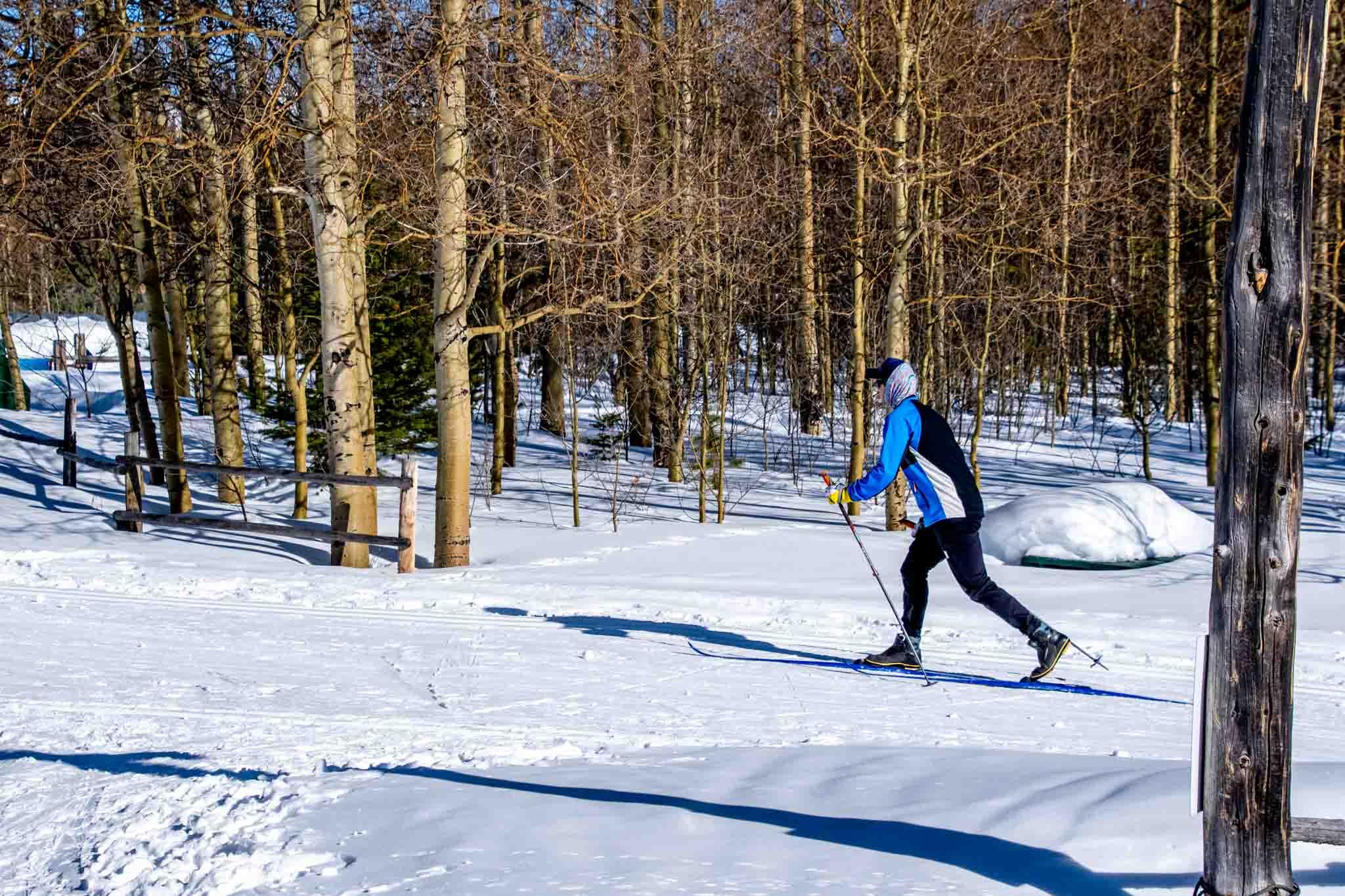 Man cross country skiing at Snow Mountain Ranch